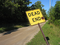 """Dead end"" sign along country road."