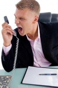 businessman shouting at phone