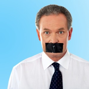 businessman with tape over his mouth.