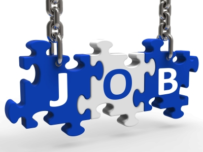 Image of puzzle pieces labeled JOBS.